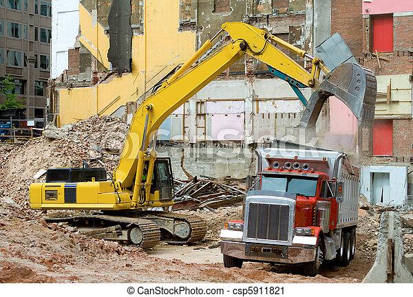 Front End Loader Dropping Demolition Materials  - csp5911821