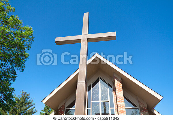 Tall Cross with Modern Church in Background  - csp5911842