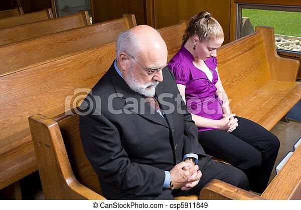 Senior Caucasian Man Woman Praying Church Pew - csp5911849