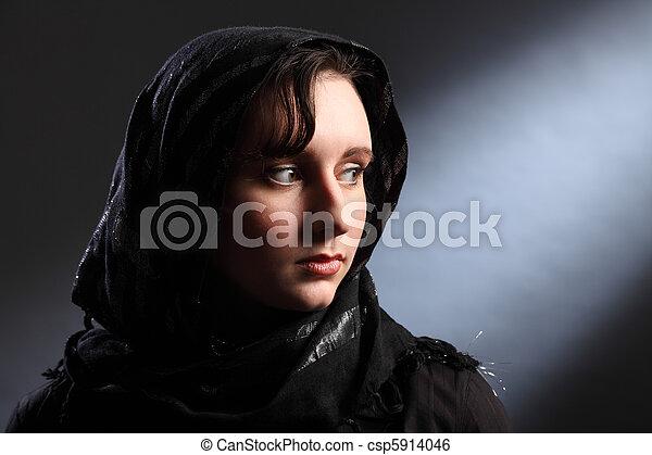 Beautiful young woman wearing headscarf in church - csp5914046