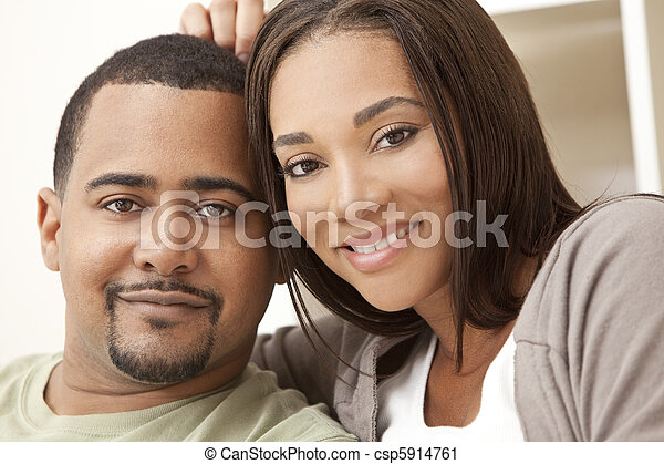 Happy African American Couple Sitting At Home - csp5914761
