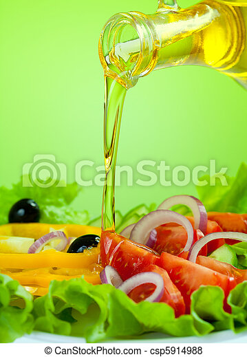 olive oil stream and healthy fresh vegetable salad - csp5914988