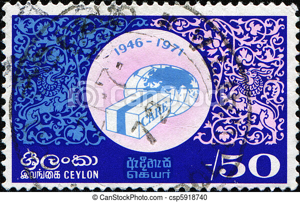 CEYLON - CIRCA 1971: A stamp printed in Ceylon honoring 25th Anniversary of Co-operative for American Relief Everywhere, shows Globe and CARE Package, circa 1971 - csp5918740
