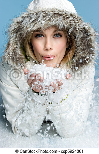 Woman Blowing Snow - csp5924861