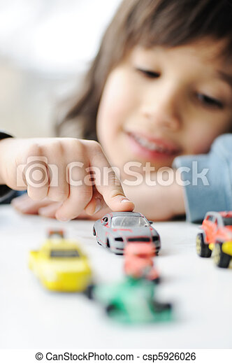 Innocence, childhood concept - playing with toy car - csp5926026