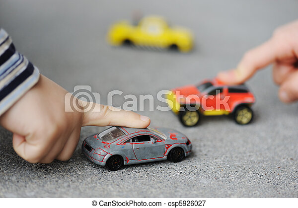 Innocence, childhood concept - playing with toy car - csp5926027