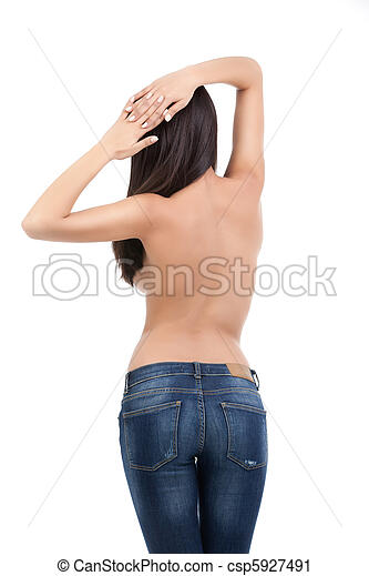 a studio image of a young, beautiful woman, wearing only a pair of blue jeans. she is topless, turned with the back to the camera, with her hands on her head.  - csp5927491