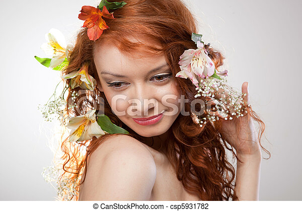 Portrait of beautiful naked woman with spring flowers - csp5931782