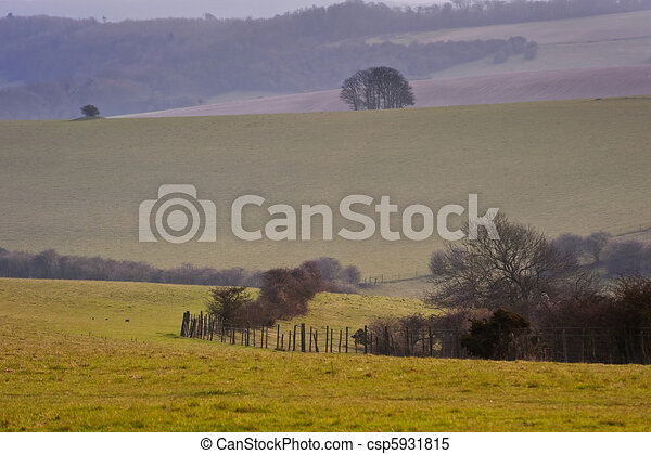 Rolling countryside landscape on hazy Summer evening - csp5931815