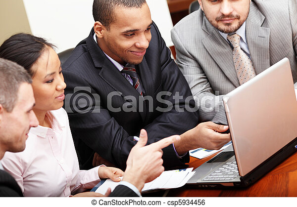 Multi ethnic business team at a meeting - csp5934456