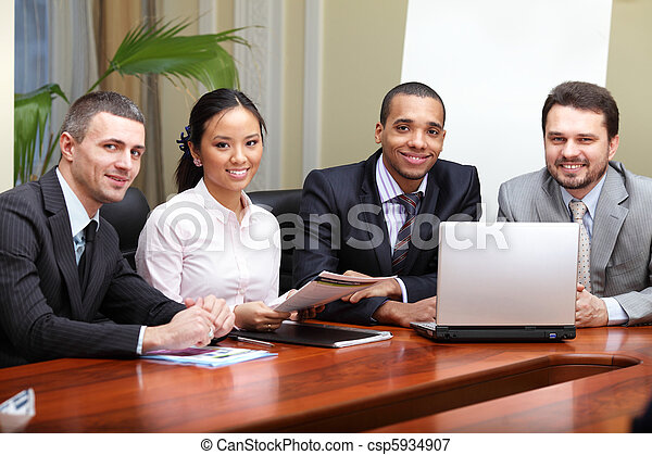 Multi ethnic business team at a meeting. Interacting. Focus on african-american man - csp5934907