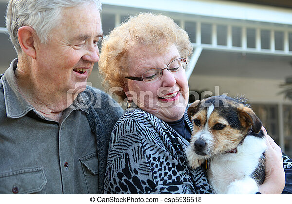 Elderly Couple with Dog - csp5936518