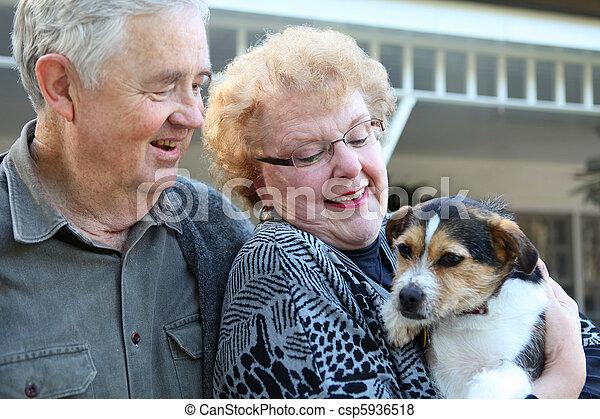 Elderly Couple with Dog - csp5936518