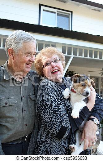 Elderly Couple with Dog - csp5936633