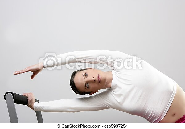 gym woman pilates stretching sport in reformer bed - csp5937254