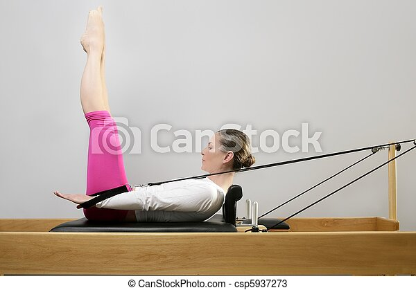 gym woman pilates stretching sport in reformer bed - csp5937273