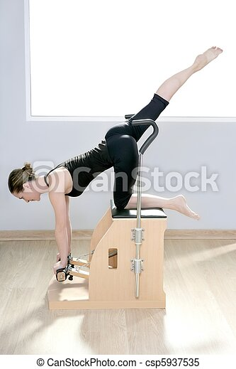 combo wunda pilates chair woman fitness yoga gym - csp5937535