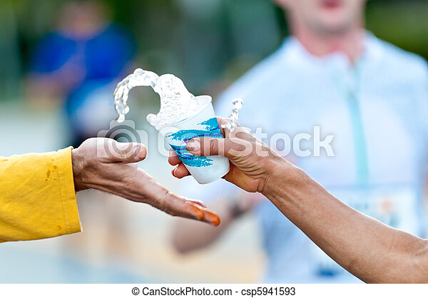 Grabbing water during a marathon - csp5941593