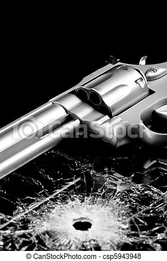gun with bullet hole in glass - csp5943948