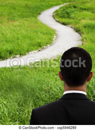 Business man thinking and watching the curved road - csp5946289