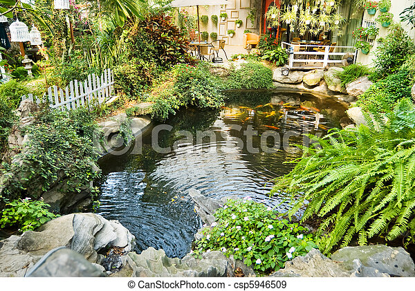 Beautiful garden with Japanese carps in the pool - csp5946509
