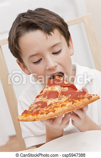 Young Boy Child Eating Slice of Pizza - csp5947388