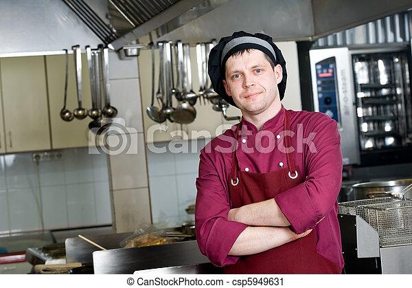 chef in uniform at kitchen - csp5949631