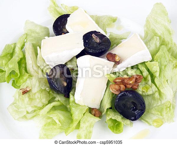 Tasty salad on white plate - csp5951035