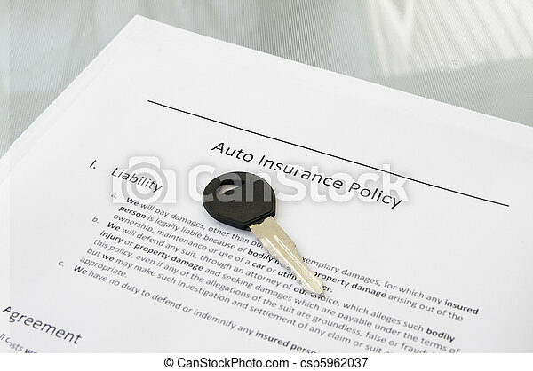 Closeup of a car key and auto insurance policy - csp5962037