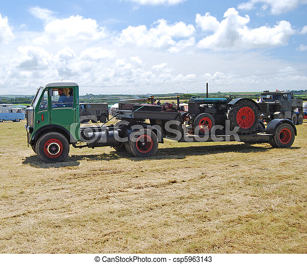 Old Articulated Lorry and Farm Tractor - csp5963143