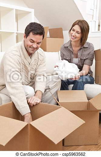 Happy Couple Unpacking or Packing Boxes Moving House - csp5963562
