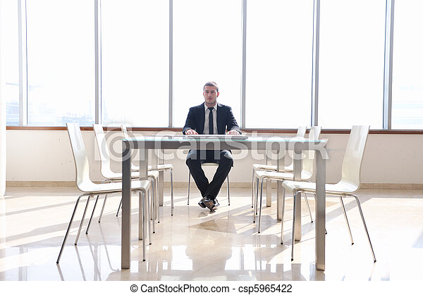 business man alone in conference room - csp5965422