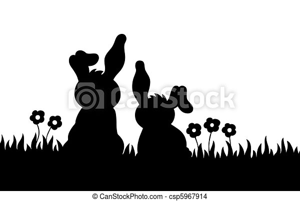Silhouette of two rabbits on meadow - csp5967914
