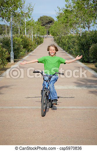 confident child riding bike or bicycle - csp5970836