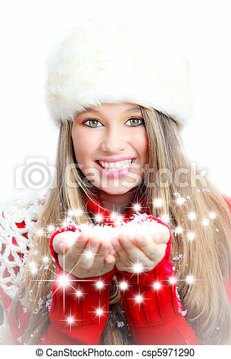 Christmas winter woman blowing snow and wishes - csp5971290
