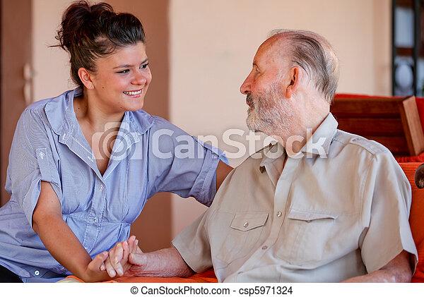 elderly man with nurse carer or granddaughter. - csp5971324