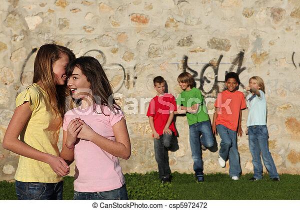 teen kids whispering, flirting - csp5972472