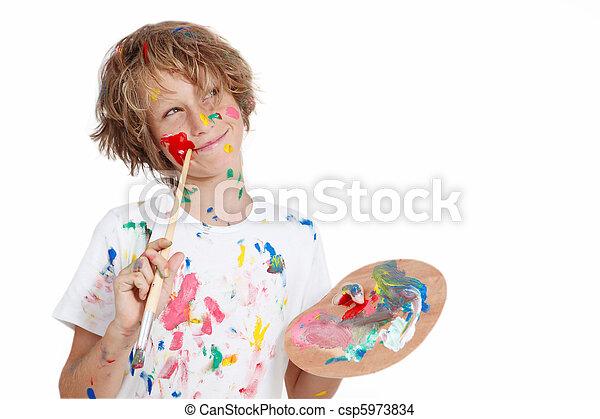 child with paint brush planning mischief - csp5973834