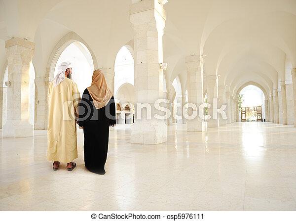 Muslim arabic couple inside big oriental empty modern building - csp5976111