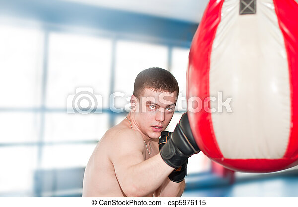Boxer with punch bag in action - csp5976115