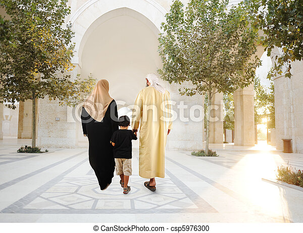Muslim arabic traditional oriental family walking together, beautiful ambient in front of the mosque - csp5976300
