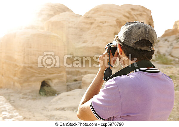 A tourist taking a photo of old archeological ruins - csp5976790