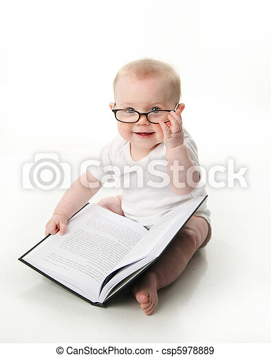 Baby reading wearing glasses - csp5978889