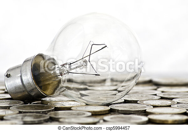 filament bulb lying on euro coins - csp5994457
