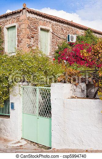 Historic mediterranean home with flower garden - csp5994740