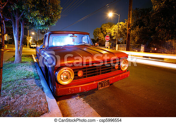 Funky vintage American pickup truck at night on a suburb street of Los Angeles, California, USA. - csp5996554