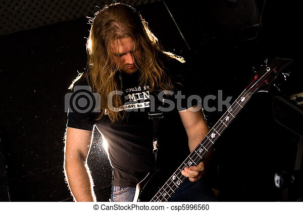 Rock guitarist playing solo. - csp5996560