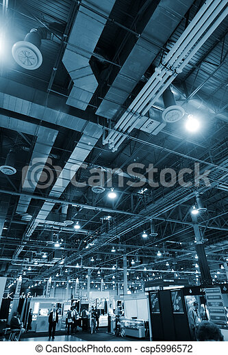 Huge industrial space hosting a trade show. - csp5996572