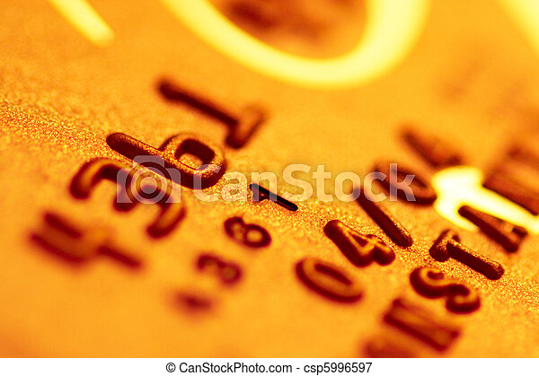 Golden credit card digits close-up - csp5996597