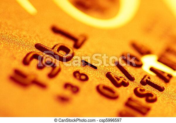 Golden credit card digits close-up - csp5996597